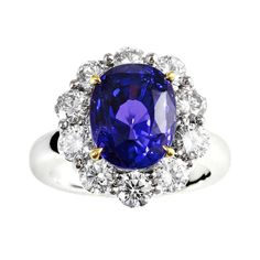 7.63 Carat No Heat Color Change Sapphire and Diamond Ring | From a unique collection of vintage cluster rings at https://www.1stdibs.com/jewelry/rings/cluster-rings/