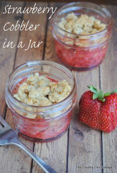 Strawberry Cobbler in a Jar -- get the super simple directions for making your own strawberry cobbler in a jar.  The perfect seasonal desser...