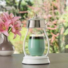 The classy white Hurricane candle warmer. Melts your candle faster and more efficiently!