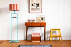 Dimmable floor lamp in mid-century modern apartment. Industrial spirit in new, colorful and extraordinary incarnation. Here in surprising combination of turquoise patina, red braided cord and circus stripe shade.