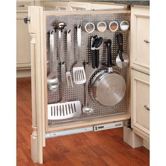 """A vertical pegboard rollout -- 6"""" base filler with stainless steel panel -- from Rev-A-Shelf. I absolutely LOVE this idea!! These pullout fillers can go in the 6"""" fillers that are on either side of the range. Maybe have one for utensils and small pans (as shown), and on the other side have a rollout with shelves for vinegar, oil, Pam, etc. #kitchensource"""