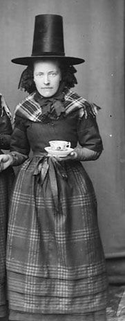 Welsh woman.  These Welsh hats are the least attractive of all the hats women have worn over the centuries.  Anyone know why they evolved?