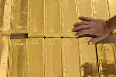 GENEVA (AP) — In Switzerland, a campaign is on to protect the country's wealth by investing in gold — a lot of gold.