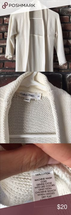 Cotton cardigan with three quarter length sleeves. Cotton cardigan with three-quarter length sleeve's and off-white. Calvin Klein Sweaters Cardigans