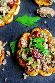 Quinoa stuffed delicata squash rings with mushrooms, cranberries, and pecans