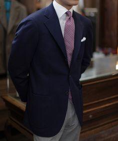 Navy sport coat, white shirt, purple tie, light grey pants
