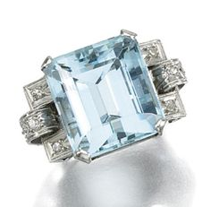 AQUAMARINE AND DIAMOND RING, 1930S. The ring claw-set to the centre with a cut-cornered, step-cut aquamarine, to openwork shoulders of geometric design, millegrain set with single-cut diamonds