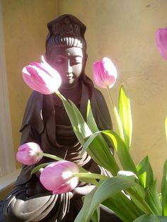 quan yin with soft tulips. Perfect.* Arielle Gabriel writes about miracles and travel in The Goddess of Mercy & The Dept of Miracles also free China toys and paper dolls at The China Adventures of Arielle Gabriel *