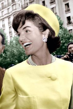 BEAUTIFUL SMILE AND YELLOW SUIT WITH MATCHING PILL BOX HAT.