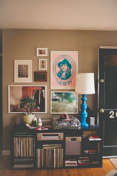 I love the pop of color lamp, and the arr of random cool art on the wall (remind's me of Miksza's living room wall).