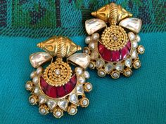 Over the Moon! Crescent earrings set with stones in the kundan style #indian #earrings