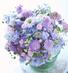 Frilly feminine bouquet in shades of blues and lavender