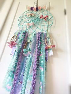Unicorn dream catcher bow holder. Perfect for a unicorn nursery or kids room