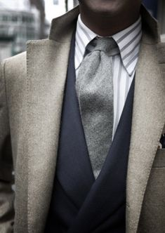 Shop this look for $181:  http://lookastic.com/men/looks/grey-dress-shirt-and-grey-tie-and-charcoal-blazer-and-grey-overcoat/2729  — Grey Vertical Striped Dress Shirt  — Grey Wool Tie  — Charcoal Blazer  — Grey Overcoat