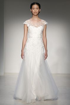 Christos - Bridal Fall 2013 TAGS:Embroidered, Floor-length, Short sleeves, Train, White, Christos, Lace, Tulle, RomanticBrowse hundreds of wedding dresses from Vera Wang, Jenny Packham, Oscar de la Renta, Pronovias, Bruce Oldfield and more (BridesMagazine.co.uk)