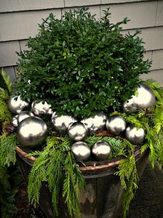 Christmas Urn - boxwood with greens & silver ornaments tied together