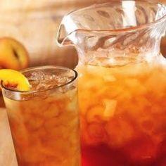 OLIVE GARDEN RASBERRY PEACH TEA  3/4 oz. (1 1/2 Tbsp.) Torani Peach syrup  1/4 oz. (1 1/2 tsp.) Torani Raspberry syrup  Ice  8 oz. (1 cup) brewed tea, chilled  Sprig of mint, for garnish  1 raspberry, for garnish