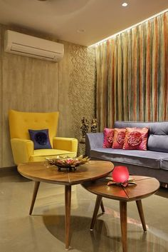 wood art house- living room interior with designed coffee table and use to textured wall complimenting the bold furniture