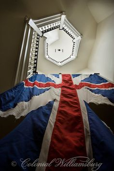 Interior of stairway to the Capitol Cupola with hanging British flag