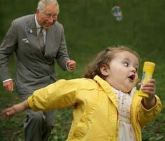Prince Charles chasing a little girl