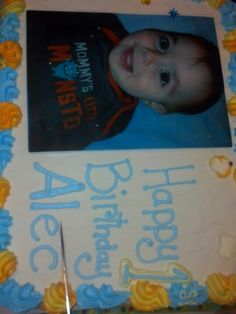 """His photo cake and he is wearing his """"Mommy's Little Monster"""" onsie"""