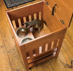 This dog-proof cat feeding station  is a great idea for keeping dogs out of cats food.  The cat climbs in through a small opening in the bot...