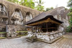 balinese traveling: Gnung Kawi Temple. Gunug Kawi is an ancient temple situated in Pakerisan River, near Tampaksiring village in Bali. The archaeological complex is carved out of the living rock, dating to 11th century.