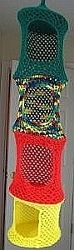 Crochet, Hanging Toy Organizer - I wonder if it'd be strong enough to support cats that might find their way in it.