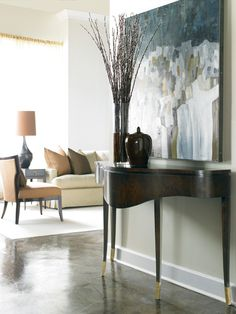 The beautiful curves of this Hickory White console define this eclectic entrance foyer.