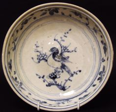 A Vietnamese Pottery Dish from the Hoi An Shipwreck. Decorated in Blue and White with a Bird on a Branch. The Well is Decorated with a Scrolling Flower Border. The Rim of the Dish has the Glaze Wiped Clean to Expose the Biscuit Body.