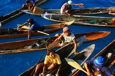 Sumatra Art and Crafts: Vendors selling art and crafts from dug-out canoes.