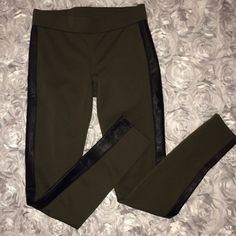 Misses leggings Dark green leggings with black leather lining on the sides. Nothing wrong with it. No trades L'amour Pants Leggings