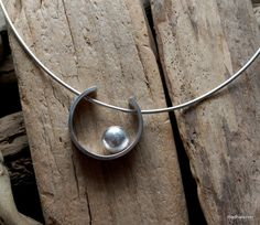 Silver pendant necklace.
