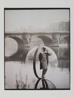 Melvin Sokolsky, Simone wears fashion by Venet, River Seine, Paris, American Harper's Bazaar, March 1963. Museum no. PH.732-1987, © Melvin Sokolsky/Victoria and Albert Museum, London