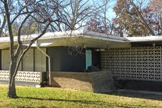 modern exterior by Sarah Greenman - Dallas home built in 1959 done with retro furniture