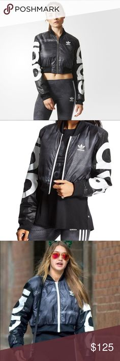 ADIDAS Rita Ora Mystic Moon Crop Bomber Jacket ADIDAS. Crop Bomber in black, silver, and white. As seen on Gigi Hadid  perfect on a casual day out or to work out in! Excellent condition  I'm usually a size small, but chose a medium for the length. SOLD OUT everywhere! Adidas Jackets & Coats