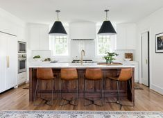 Sally Zwartjes' Seattle home was definitely a fixer-upper; after she tapped designer Casey Keasler to completely renovate it, the space looks like a different house. Classic White Kitchen, Home, Kitchen Remodel, Black Kitchens, New Kitchen, Residential Interior Design, Kitchen Interior, Interior Design Kitchen, Colonial House