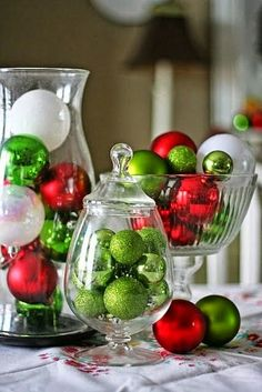 Christmas Centerpiece. Fill your favorite glass containers with ornaments of your favorite holiday season colors, set out on table in group of 3 's and Enjoy!