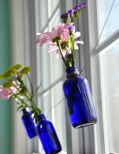 Blue bottles with wild flowers or daisies are a cute and cheap way to decorate your vintage wedding!