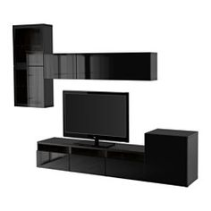 IKEA - BESTÅ, TV storage combination/glass doors, black-brown/Selsviken high gloss/black clear glass, drawer runner, push-open, , The drawers and doors have integrated push-openers, so you don't need handles or knobs and can open them with just a light push.Three large drawers make it easy to keep remote controls, game controlers and other TV accessories organized.It's easy to keep the cords from your TV and other devices out of sight but close at hand, as there are several cord outlets at…