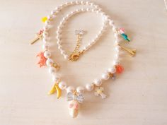 I think i might begin dazzling my pearl necklaces with charms....