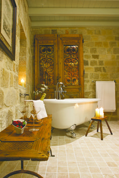 "EXCLUSIVE SUITES BOUTIQUE HOTEL. MEDIEVAL TOWN, RHODES, GREECE. - ""Katina"" suite. The door is from a house in Saloniki. Cypress wood, ca 1930. - kokkiniporta.com"