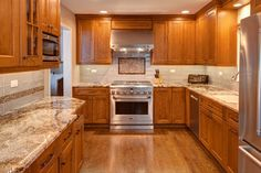 Sedna granite with cherry cabinets