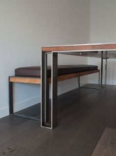 The Charles Table and Bench are made using locally sourced white oak and powder coated steel. The table top is traditionally joined and finished with natural oil. Our signature Post legs are mounted flush with countersunk stainless steel machine fasteners. The Charles Bench is a steel structure with a hardwood band. The inset cushions are upholstered in leather.