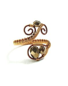 Coiled copper wire and faceted beads give this shapely ring texture and depth. #etsy