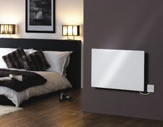 The Dimplex Girona Glass Panel Heater is perfect for bedrooms and bathrooms. We ensure silent operation and full functionality in wet areas thanks to its splash-proof rating. White Paneling, Glass Panels, Couch, Bedroom, Furniture, Home Decor, Division, Bathrooms, Electric