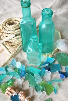 "DIY: Sea Glass Bottles merrybrides: "" I Love the frosted colors in Beach Glass. You will need : * Mod Podge (or watered down white glue parts glue to 1 part water) * Food coloring ( I used the neon. Painted Glass Bottles, Bottles And Jars, Glass Jars, Sea Glass, Glass Paint, Glass Beach, Bottle Candles, Glass Candle, Painted Jars"