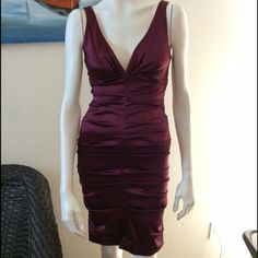 Purple little dress. Cute prom/bridesmaid dress. There is a small stain on the left side (pic #4) and because it's dry clean only I couldn't clean it. Nicole Miller Dresses