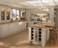 Burford Grey Kitchen. A subtle matt grey shaker style door, shown with pewter effect cup handles.