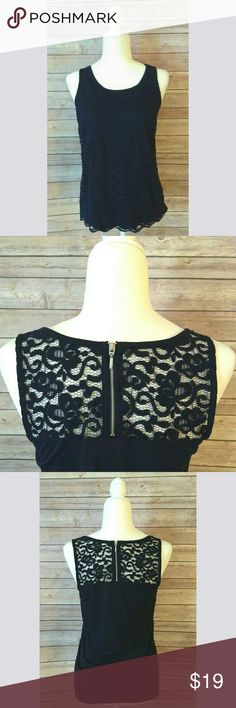 New York & Company lace sleeveless top NWOT New York & Company lace top in navy blue.  It has a layer of lace all over the front and the upper part of the back also has lace and a zipper.  It has never been worn but the actual tag is gone.  The plastic tag fastener and the size sticker are still on the top.   Pet free smoke free home. New York & Company Tops